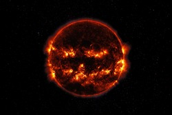 Sunspot And Solar Flare Activity. The sinister black sun in space. Sun on Halloween. Elements of this image furnished by NASA