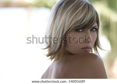 Suntanned girl with blond highlights