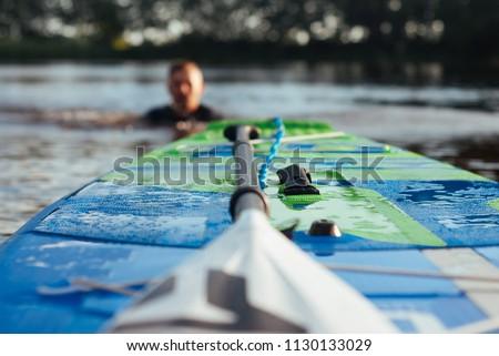 SUP Board and paddle closeup,