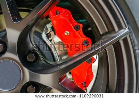 Super Car Brakes. Disc Brake. Disc Pads, Wheel Bearing, Caliper Assembly. Car Brakes Closeup Photo. #1109290031