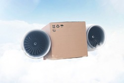 Super express delivery, future concept. Packing cardboard box with airplane turbines flies in the sky with clouds. Delivery of goods and Cargo transportation. Autopilot