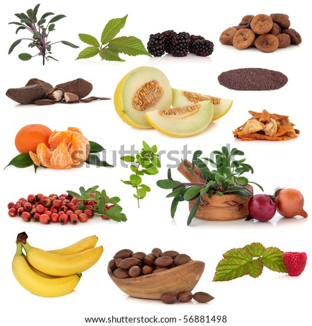 Super food collection of fruit, nuts, herbs and spices, very high in antioxidants and vitamins, isolated over white background.