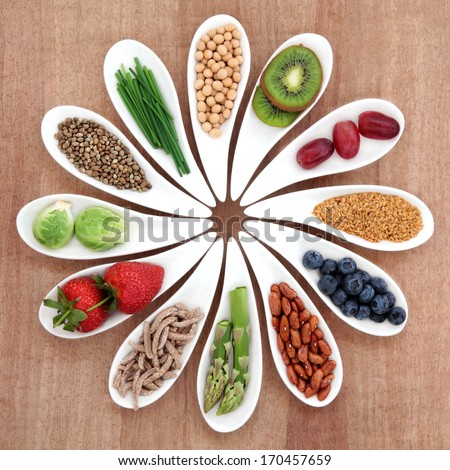 Super food health food selection in white bowls over papyrus background.