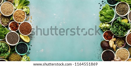 Super food or vegetarian food concept. Seeds, cereals, beans, vegetables, herbs for healthy cooking on blue stone background top view with copy space Stock photo ©