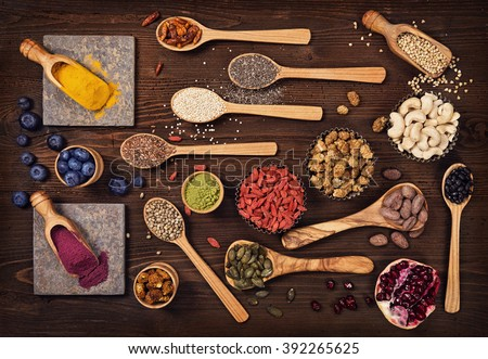 Super foods in spoons and bowls on a wooden background #392265625