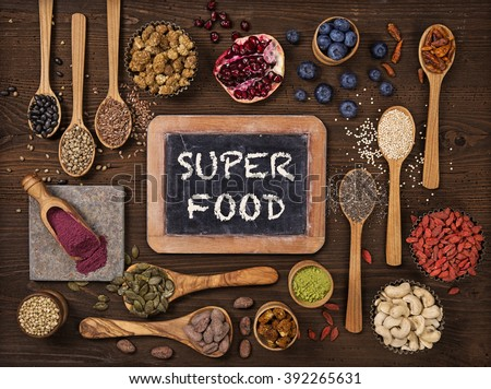 Super foods in spoons and bowls on a wooden background Stock photo ©