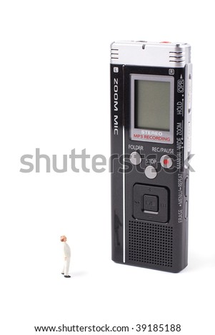 Super gadget - tiny man and huge voice recorder isolated