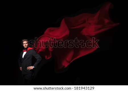 super hero business man in red cape