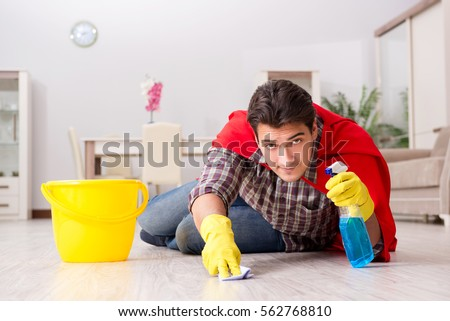Super hero husband cleaning floor at home #562768810