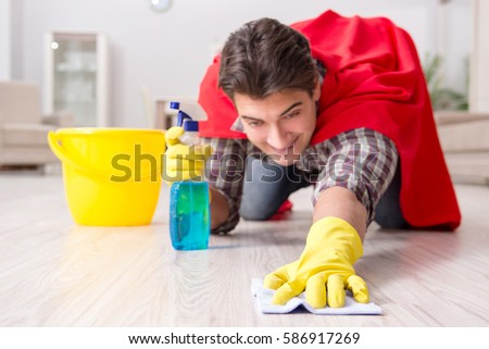 Super hero husband cleaning floor at home #586917269