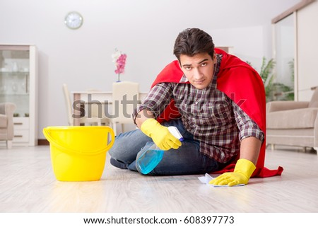Super hero husband cleaning floor at home #608397773
