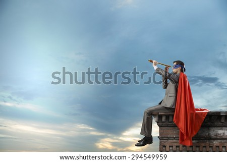 Super hero sitting on top of building and looking in spyglass #294549959