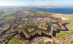 Super high resolution aerial image of the medieval Naarden Fortress village in the Netherlands with defence walls and canals