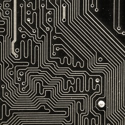 Super macro of electronic material inside computer.