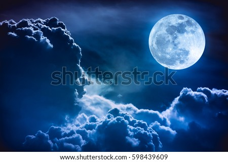 Super moon. Attractive photo of background night sky with cloudy and bright full moon. Nightly sky with beautiful full moon. The moon were NOT furnished by NASA. - Shutterstock ID 598439609
