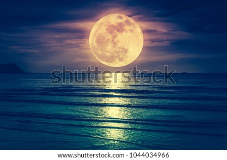 Super moon. Colorful sky with cloud and bright full moon over seascape in the evening. Serenity nature background, outdoor at nighttime. Cross process. The moon taken with my own camera. - Shutterstock ID 1044034966