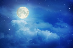 Super moon.Full moon in night sky with the clouds ,Elements of this image furnished by NASA.