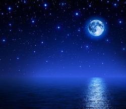 super moon in starry sky on sea