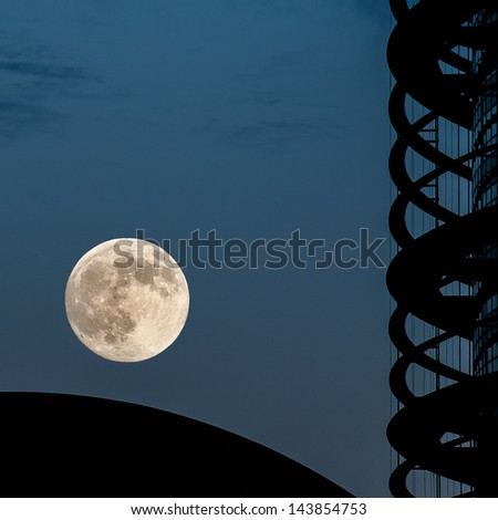 Super moon on clear sky over European Parliament building in Strasbourg, France