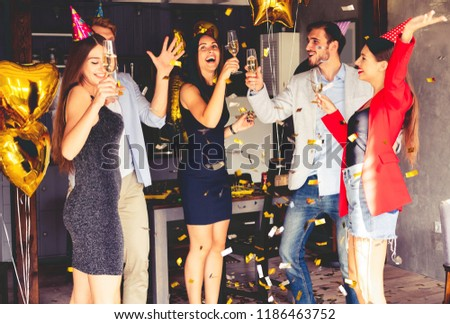 Super party with best friends. A company of very positive friends have fun at a party. Young group of happy friends celebrating birthday #1186463752
