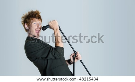Super rock star lead singer belts out a high note
