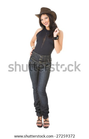 Super sexy rodeo cowgirl in  jeans and a cowboy hat isolated