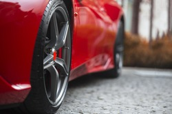 Super Sport Racing Car Detail on a Wheel and Red Breaks