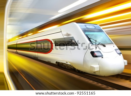 super streamlined train with motion blur moves in tunnel - stock photo