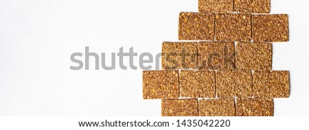 Super-Useful rye multi-grain whole-grain crackers with different seeds laid on like building block with space for text. superfoods healthy organic products concept.