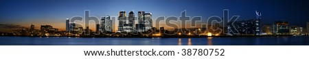 Super wide Panorama of the Canary Wharf area at sunset, London.
