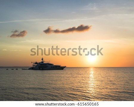 Super yacht watching the sunset over the sea. #615650165