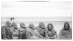 Superb black and white religious themed sand sculpture on the beach of Valencia, Spain
