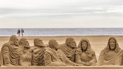 Superb religious themed sand sculpture on the beach in Valencia, Spain