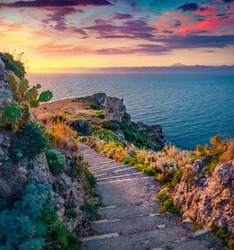 Superb spring dawn on Milazzo cape with olf staircase. Astonishing morning scene of Sicily, Italy, Europe. Amazing seascape of Mediterranean sea. Beauty of nature concept background.