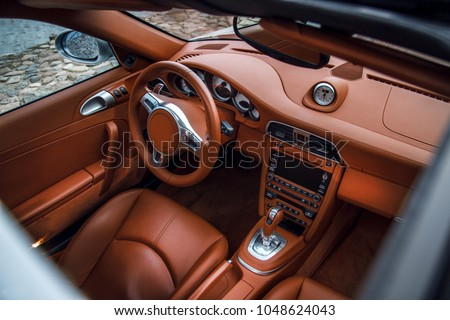 Supercar interior view from above. View throught sunroof  #1048624043