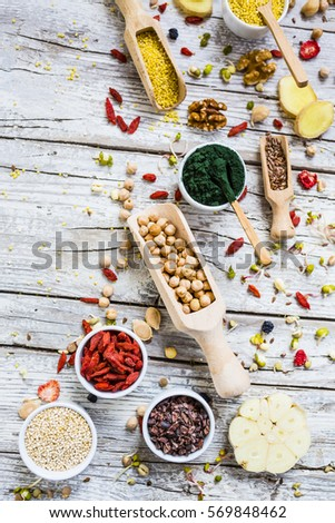 Superfood and healthy food on wooden background.