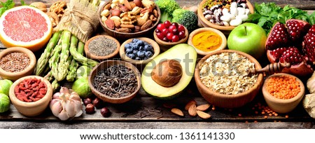 Superfoods, vegetables, fruits, seeds, legumes, nuts and grains for vegan and vegetarian eating. Clean eating. Detox, dieting food concept. Panorama. Banner.