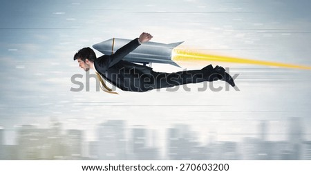 Superhero business man flying with jet pack rocket above the city concept #270603200