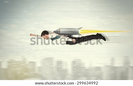 Superhero business man flying with jet pack rocket above the city concept #299634992