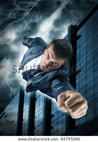 Superhero businessman flying over downtown in thunderstorm