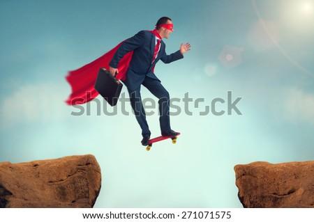 superhero businessman making a risky leap of faith on a skateboard Сток-фото ©