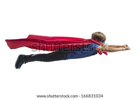 Superhero kid flying fast over the city