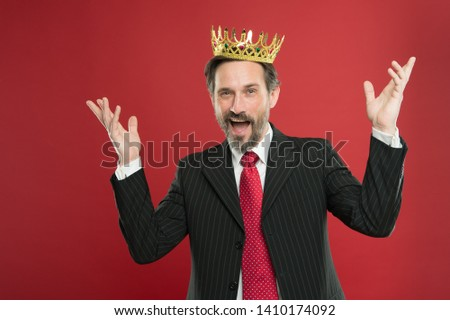 Superior and narcissistic. Become king ceremony. I am just superior. Award and achievement. Feeling superiority. Being superior human. Man bearded guy in suit hold golden crown symbol of monarchy.