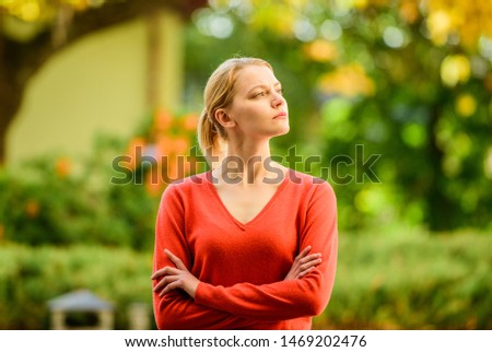Superior and self confident. Stylish and confident. Confident woman. Sensual blonde girl outdoors sunny day nature background. She is offended but serious. Proud and confident. Woman crossed hands.