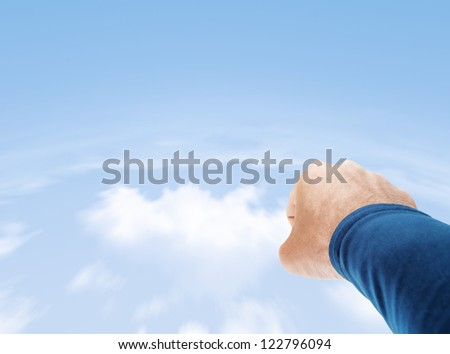 Superman hand flying in cloudy sky with copy space