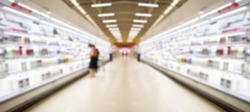 Supermarket Aisle with dairy products in refrigerator blur background