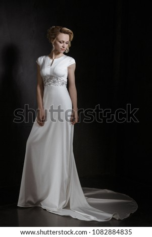 Supermodel in Wedding Bridal White Lace Dress, Fashion Make Up and hair style with diamond jewelry earrings, Studio Lighting Gray Background, full body fashion pose