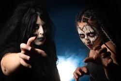 Supernatural entities, portrait of two supernatural entities, artistic makeup, black background, Low Key portrait, selective focus.