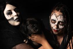 Supernatural entities, portrait of two supernatural entities holding their sacrifice, artistic makeup, black background, Low Key portrait, selective focus.