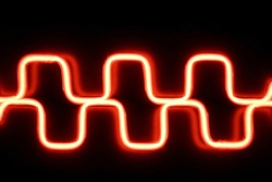 Superposition of meander waves on oscilloscope screen glowing in darkness. Abstract science and technology background. Luminous energy flow. Electronics, modern medical equipment, physics, mathematics